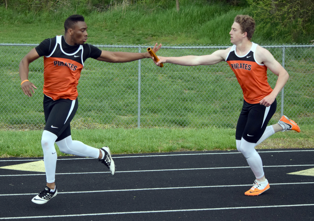 BRYCE MERENESS/Citizen photo Platte County junior Jacob Mundell, right, hands the baton in the 4x200 meter relay to senior Lloyd Lockett at the Platte County invitational held, Tuesday, April 26 at Pirate Stadium