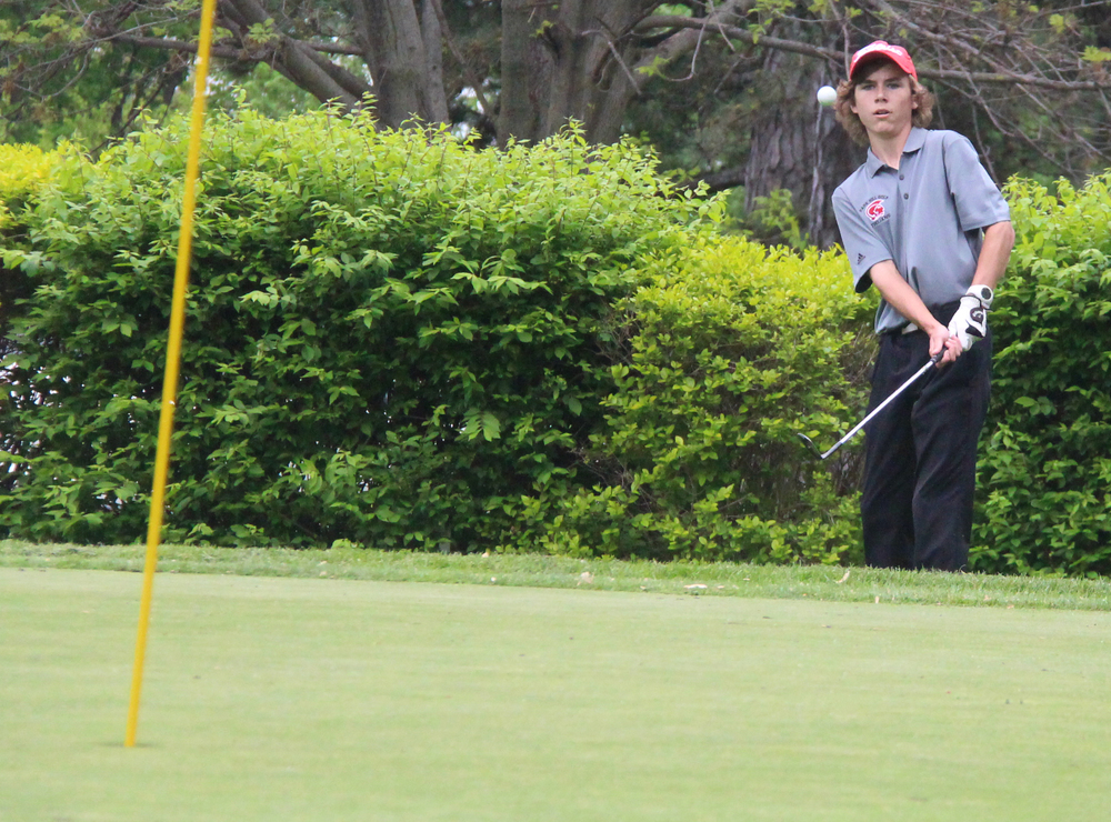 BRYCE MERENESS/Citizen photo Park Hill junior Kris Snodgrass watches a chip shot at the Suburban Conference Red Division championships held Monday, April 25 at Moila Country Club in St. Joseph, Mo.