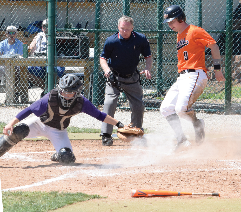 BRYCE MERENESS/Citizen photo Platte County junior catcher Justin Mitchell, right, pops up after sliding in ahead of the tag from North Kansas City's catcher during the Northland Invitational championship game held Saturday, April 23 at Oak Park High school in Kansas City, Mo.