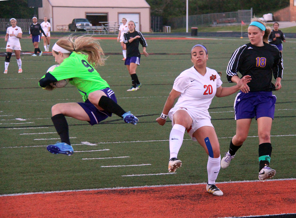ROSS MARTIN/Citizen photo Kearney goalkeeper Alexandra Alter, left, goes flying after colliding with Platte County sophomore forward Destinee Smith (20) during a game Wednesday, April 27 at Pirate Stadium.