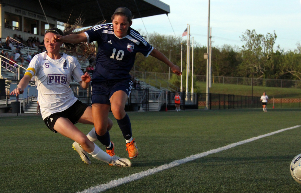 ROSS MARTIN/Citizen photo Park Hill South senior forward Meghan Jones (left) goes down while making contact with a Truman defender during a Suburban Conference Red Division matchup Friday, May 6 at Park Hill District Soccer Complex in Riverside, Mo.