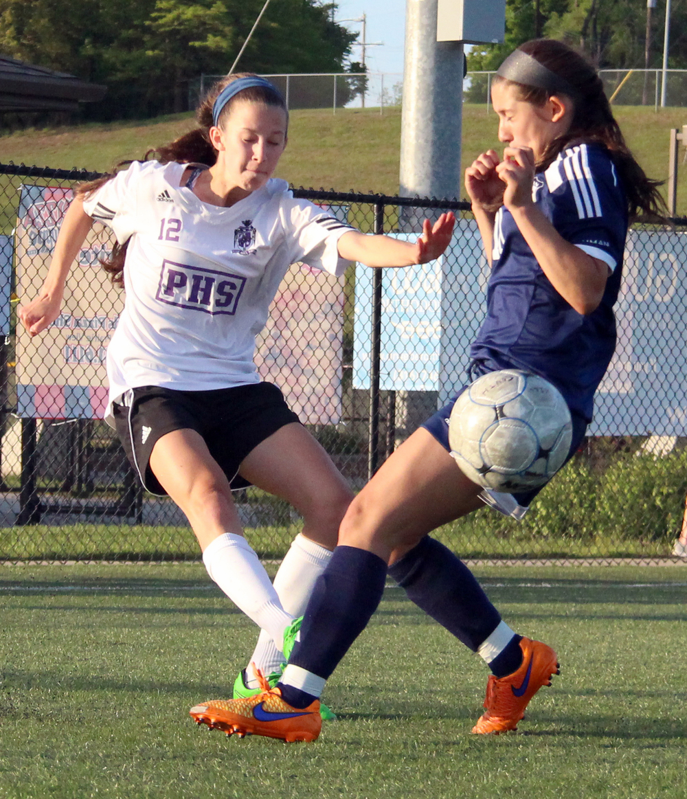 ROSS MARTIN/Citizen photo Park Hill South junior Lexi Maddox, left, sends in a cross vs. Truman on Friday, May 6 at Park Hill District Soccer Complex in Riverside, Mo.