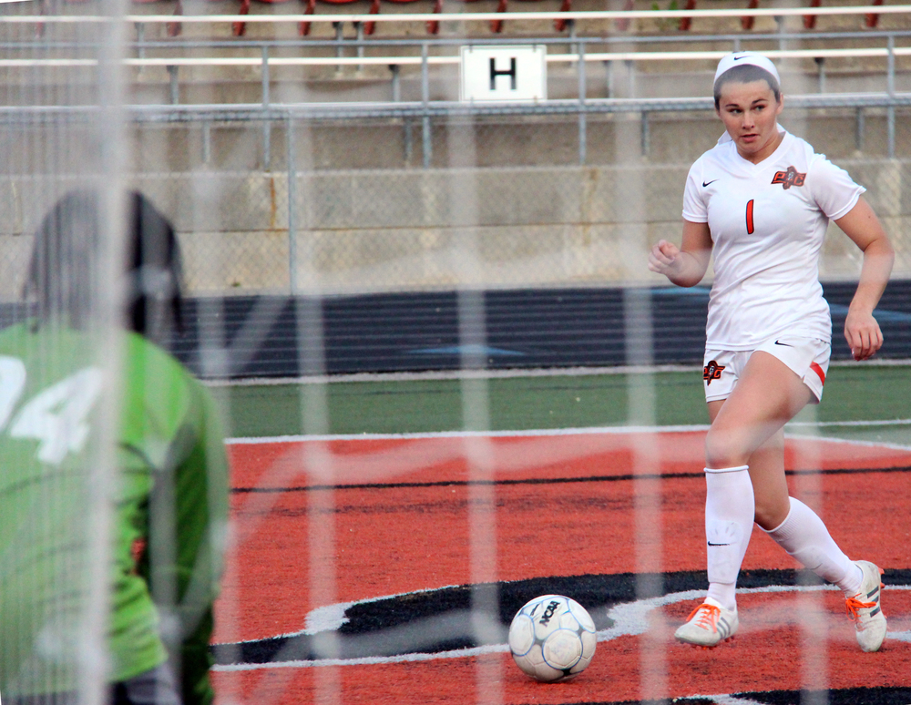ROSS MARTIN/Citizen photo Platte County senior midfielder Brooke Zenner dribbles into the 18-yard box against Grandview on Thursday, May 5 at Platte County High School.