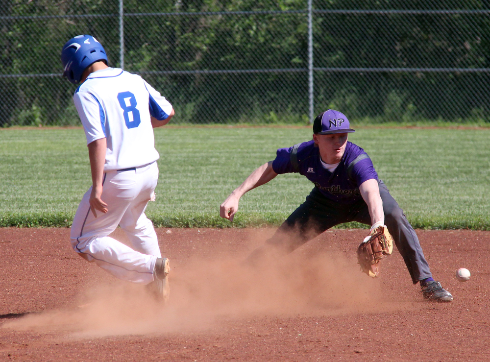 ROSS MARTIN/Citizen photo North Platte shortstop Andrew Roberts stretches to field a throw from the outfield as West Platte senior Kyle Tabaka pops up from a slide.