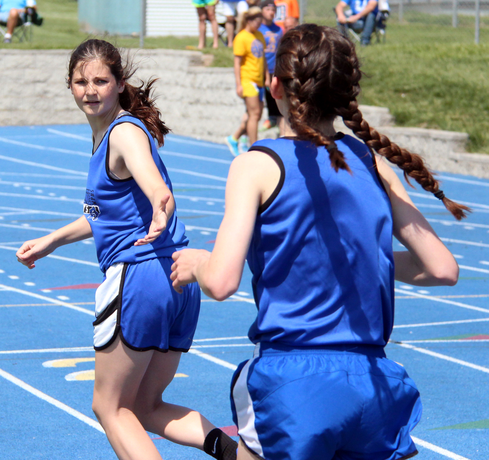 ROSS MARTIN/Citizen photo West Platte freshman Lea Moose, left, prepares to take a handoff from freshman Lindsay Goodwin during the 4x800-meter relay Saturday, May 7 in the Class 2 District 7 meet held at Sam Duncan Field in Higginsville, Mo.