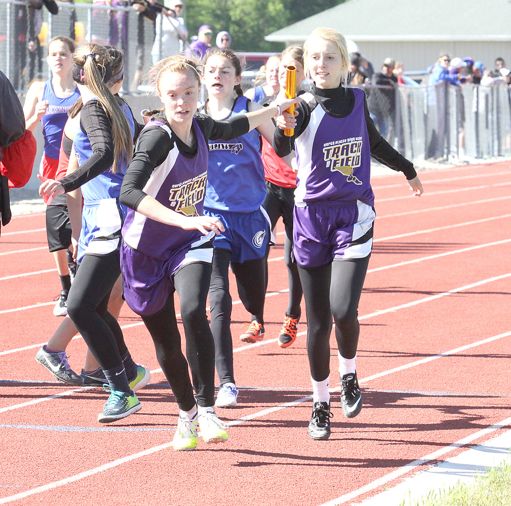 ROSS MARTIN/Citizen photo North Platte's McKenna Fulton, right, hands off to Gracie Roach in the 4x400-meter relay during the Class 2 Sectional 4 meet Saturday, May 14 in Albany, Mo. West Platte's Sikoya Richard, center, can be seen making the Bluejays' handoff.