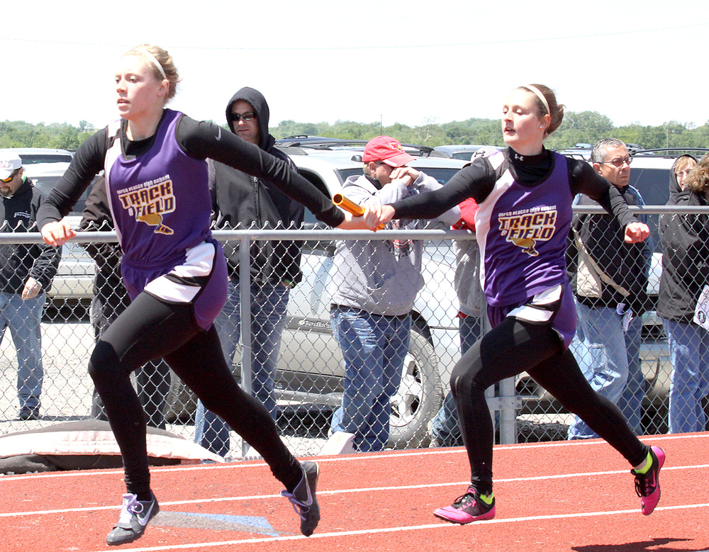ADAM JOHNSON/Mound City News photo North Platte's Brittney Gerling, left, takes a handoff from Emmie Lee in the 4x200-meter relay during the Class 2 Sectional 4 meet Saturday, May 14 in Albany, Mo.
