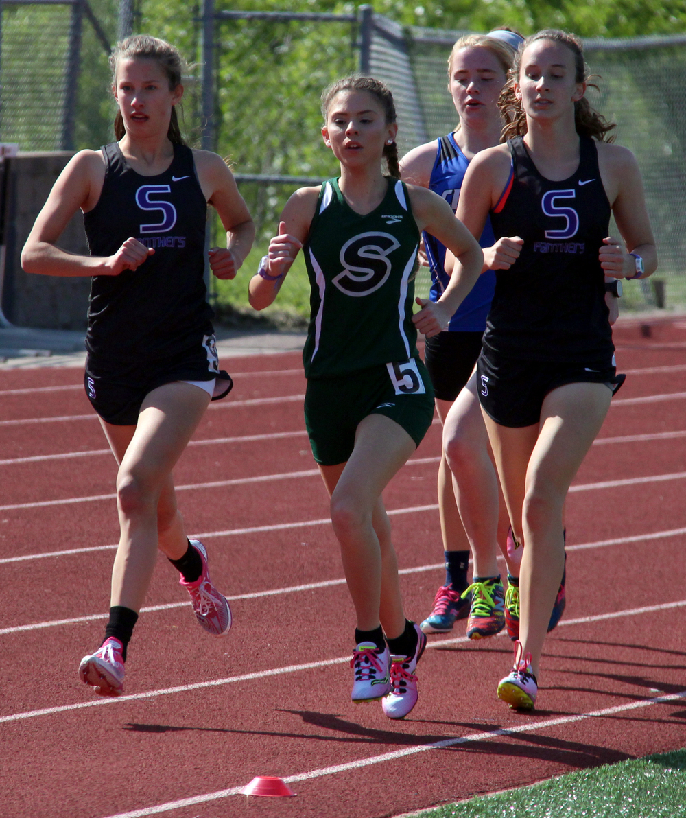 ROSS MARTIN/Citizen photo Park Hill South's Lexi Maddox, left, and Marti Heit, right, battle with Staley's Katelin Fiorino for position in the 3,200 run.