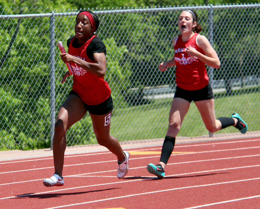 ROSS MARTIN/Citizen photo Park Hill's Sephora Koudou, left, takes a handoff from Jena Hahlbeck during the 4x200 relay.