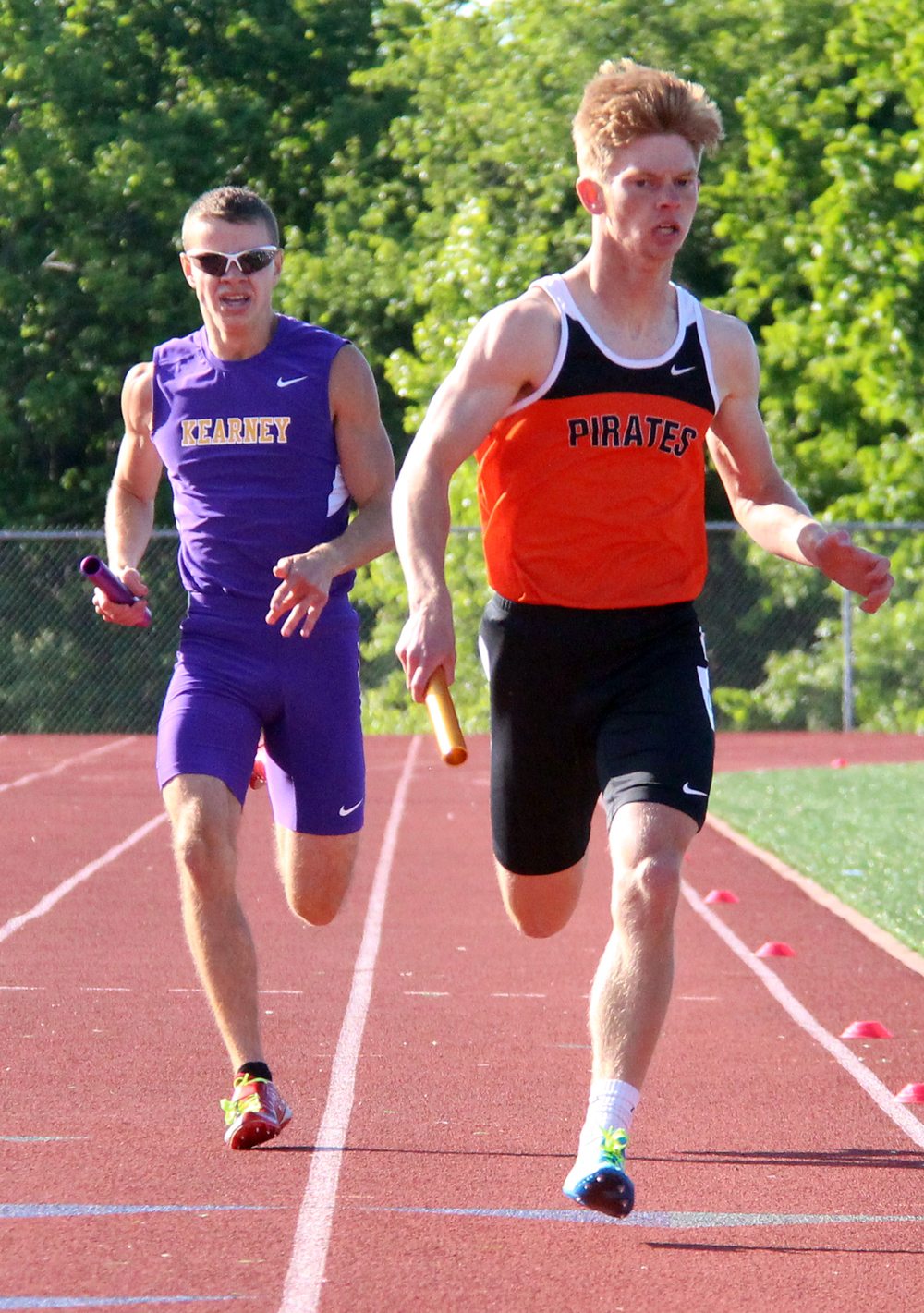 ROSS MARTIN/Citizen photo Platte County senior David Fulk, right, leads Kearney's Nick Pierce down the final straightaway of the 4x400-meter relay during the Class 4 District 8 meet held Saturday, May 14 at Excelsior Springs High School in Excelsior Springs, Mo.