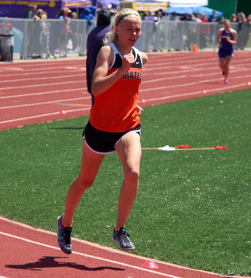 ROSS MARTIN/Citizen photo Platte County sophomore Rebekah Geddes, left, leads second-place Anne Wood of Kearney, right, on the third lap of the 1,600-meter run during the Class 4 District 8 meet Saturday, May 14 at Excelsior Springs High School in Excelsior Springs, Mo.