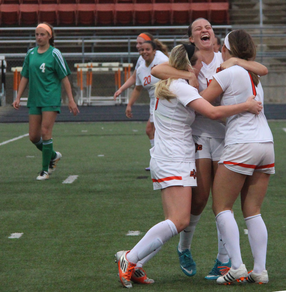 ROSS MARTIN/Citizen photo Platte County junior defender Calle Boe, center, hugs junior midfielder Kianna Castro, left, and senior midfielder Brooke Zenner after Zenner's corner kick set up Destinee Smith (not pictured) for the winning goal in overtime against Smithville in the Class 3 District 16 championship game Thursday, May 19 at Pirate Stadium.