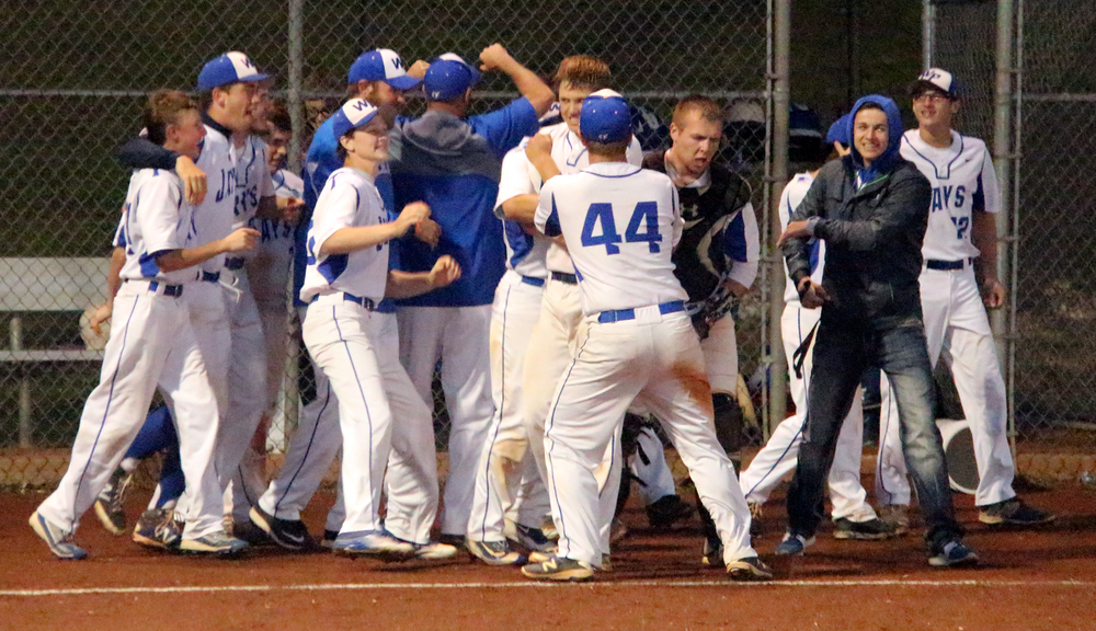 ROSS MARTIN/Citizen photo West Platte's players celebrate following a 5-3 win in 10 innings against Mid-Buchanan in the Class 2 District 16 championship game Thursday, May 19 at Benner Park in Weston, Mo.
