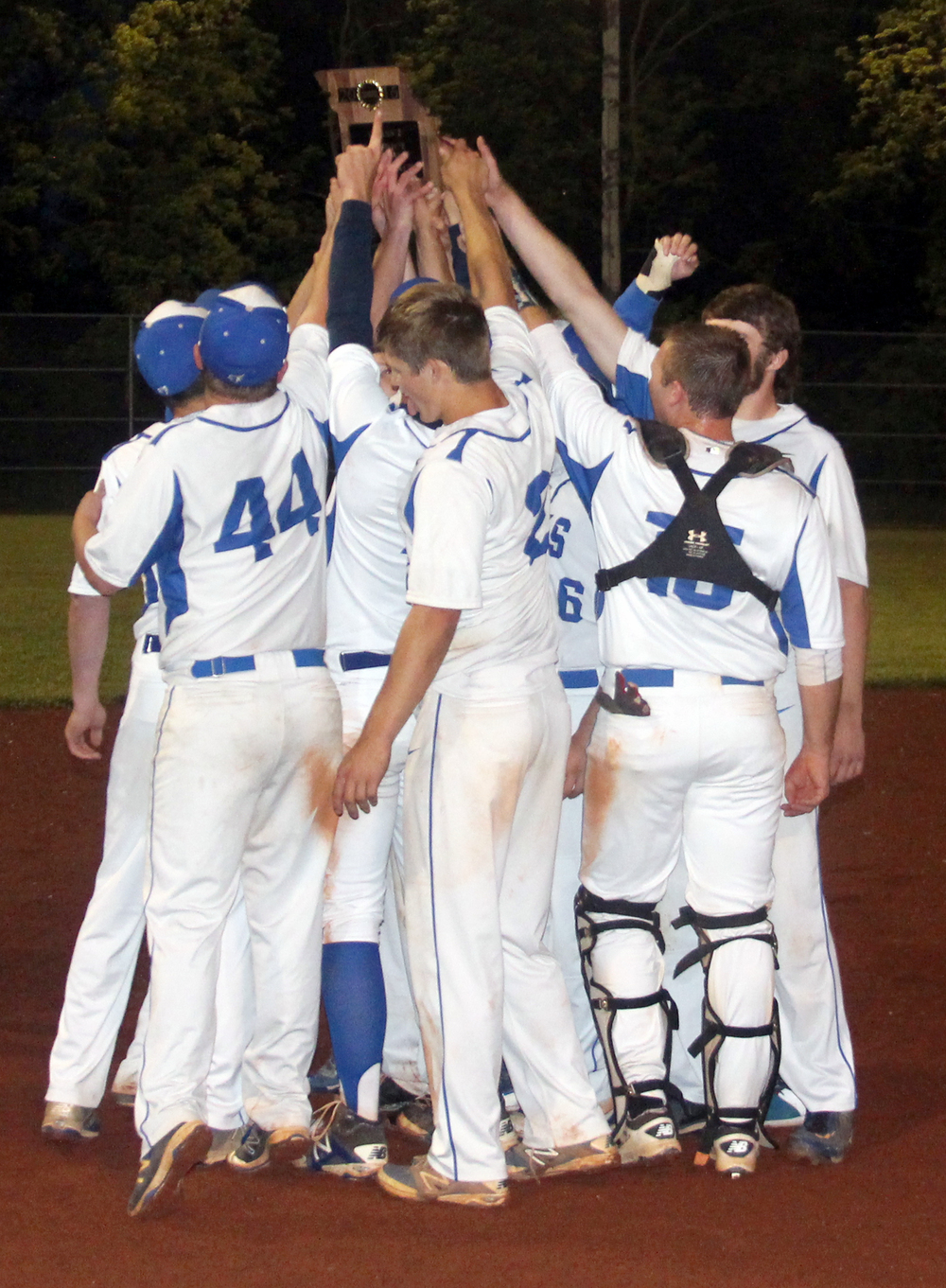 ROSS MARTIN/Citizen photo West Platte's players celebrate with the Class 2 District 16 championship plaque following a 5-3 win against Mid-Buchanan in 10 innings Thursday, May 19 at Benner Park in Weston, Mo.