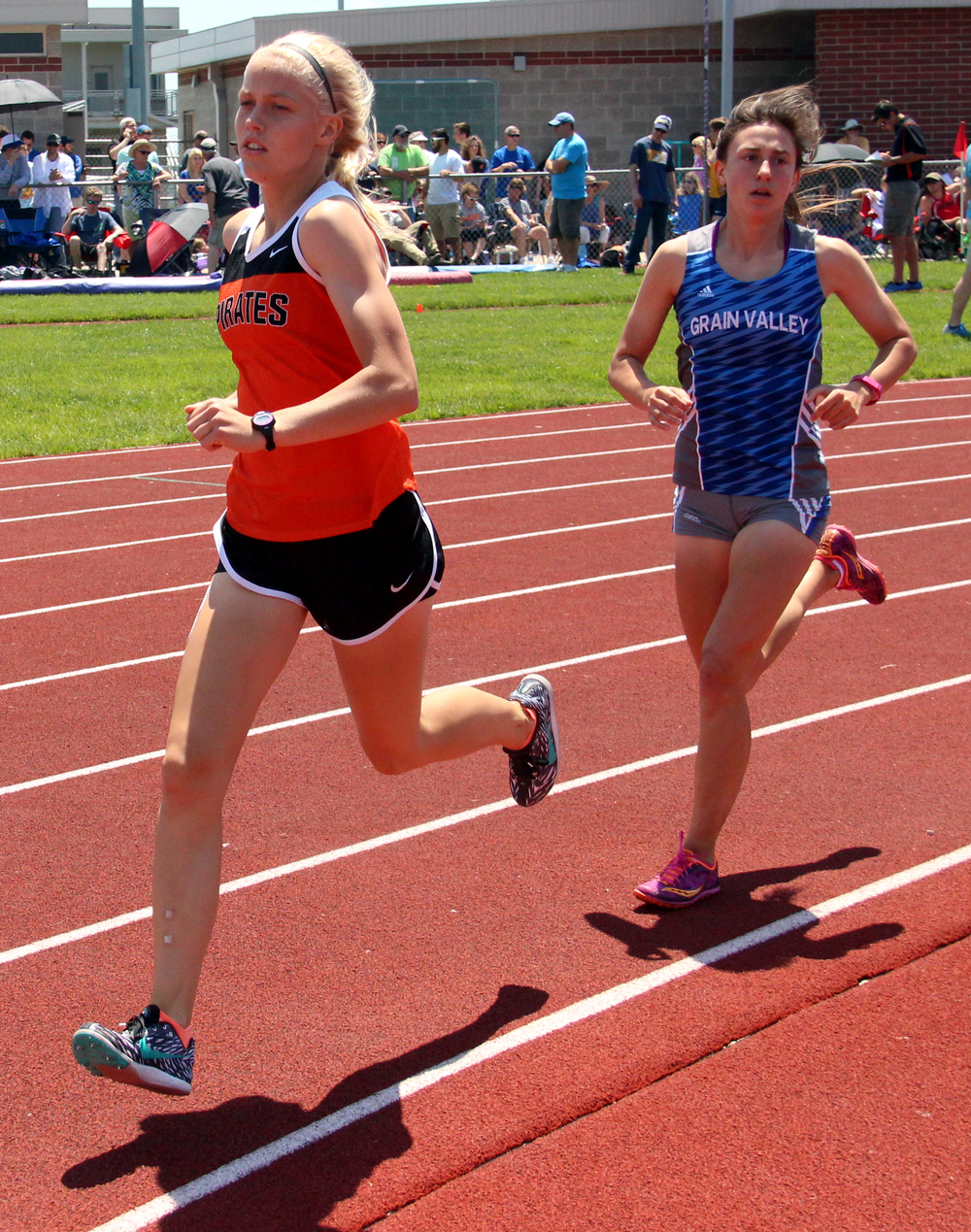 Platte County sophomore Rebekah Geddes, left, runs in the 1,600 meters Saturday, May 21 during the Class 4 Sectional 4 meet at North Kansas City District Activities Complex in Kansas City, Mo.