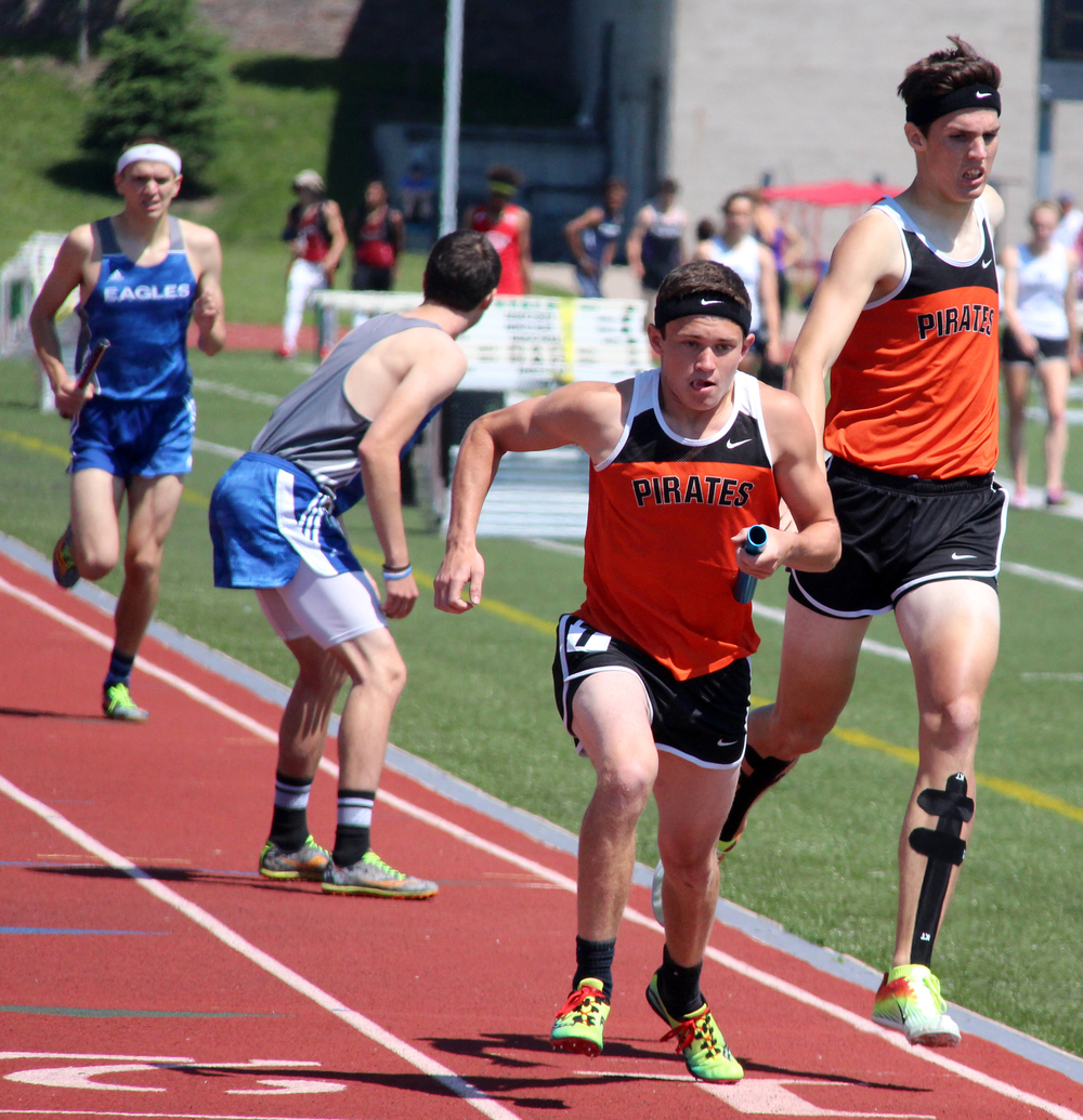 ROSS MARTIN/Citizen photos Platte County's JD Crawford, center, takes a handoff from Keegan Cordova in the Class 4 Sectional 4x800-meter relay Saturday, May 21 at North Kansas City District Activities Complex in Kansas City, Mo.