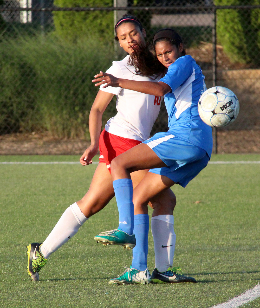 ROSS MARTIN/Citizen photo Park Hill senior midfielder Raena Woodruff, left, collides with a Liberty defender during the second half of a Class 4 sectional matchup Tuesday, May 24 at Park Hill District Soccer Complex in Riverside, Mo.