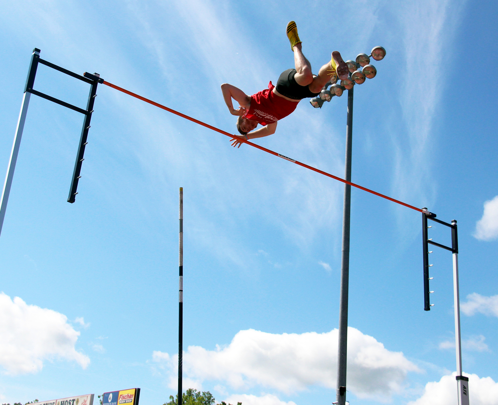 ROSS MARTIN/Citizen photo Park Hill senior Chris Nilsen clears the bar during the pole vault competition Saturday, May 28.