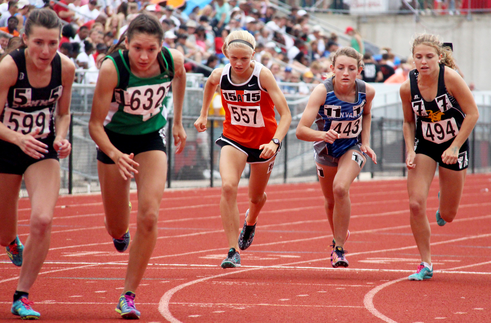 ROSS MARTIN/Citizen photo Platte County sophomore Rebekah Geddes, center, starts the 1,600-meter run Friday, May 27 during the Class 4 Missouri State Track and Field Championships at Adkins Stadium in Jefferson City, Mo. She came back to finish third for the first of three medals won and three school records set during the weekend.