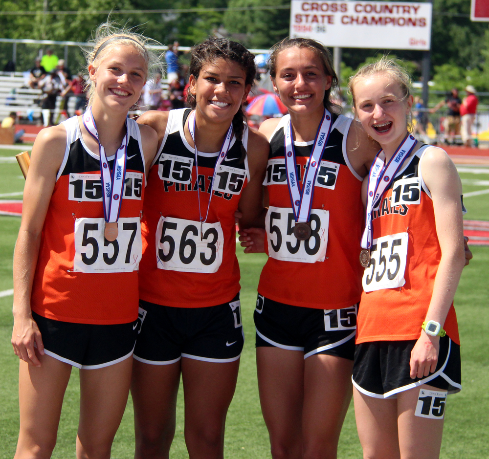 ROSS MARTIN/Citizen photo Members of Platte County's 4x800-meter relay team (from left) Rebekah Geddes, Ava White, Rachel Gilbert and Jessica Clark smile on the podium with their sixth-place medals Saturday, May 28 during the Class 4 Missouri State Track and Field Championships in Jefferson City, Mo.
