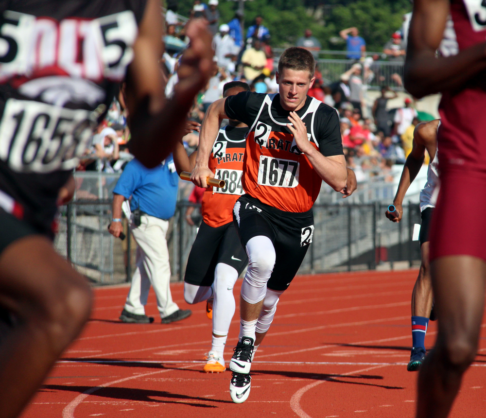 ROSS MARTIN/Citizen photo Platte County senior Tyler Clemens, center, takes a handoff in the 4x400-meter relay Saturday, May 28 during the Class 4 Missouri State Track and Field Championships at Adkins Stadium in Jefferson City, Mo.
