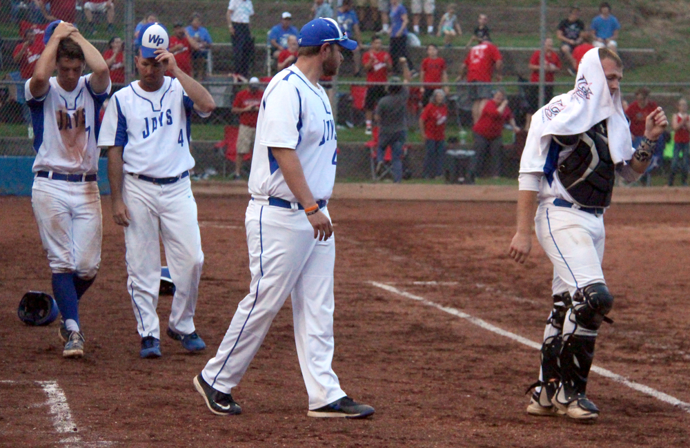 ROSS MARTIN/Citizen photo West Platte players McKaulley Stephenson (left) and Peyton Morris (right) along with coaches Tanner Lawson and Mitch Giger (center) leave the dugout following a 1-0 loss in 10 innings to Lincoln in a Class 2 quarterfinal Wednesday, May 25 at Benner Park in Weston, Mo.