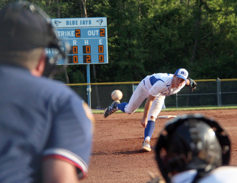 ROSS MARTIN/Citizen photo West Platte senior pitcher McKaulley Stephenson watches his delivery to catcher Peyton Morris, front right, during a Class 2 sectional matchup with Lincoln on Wednesday, May 25 at Benner Park in Weston, Mo.