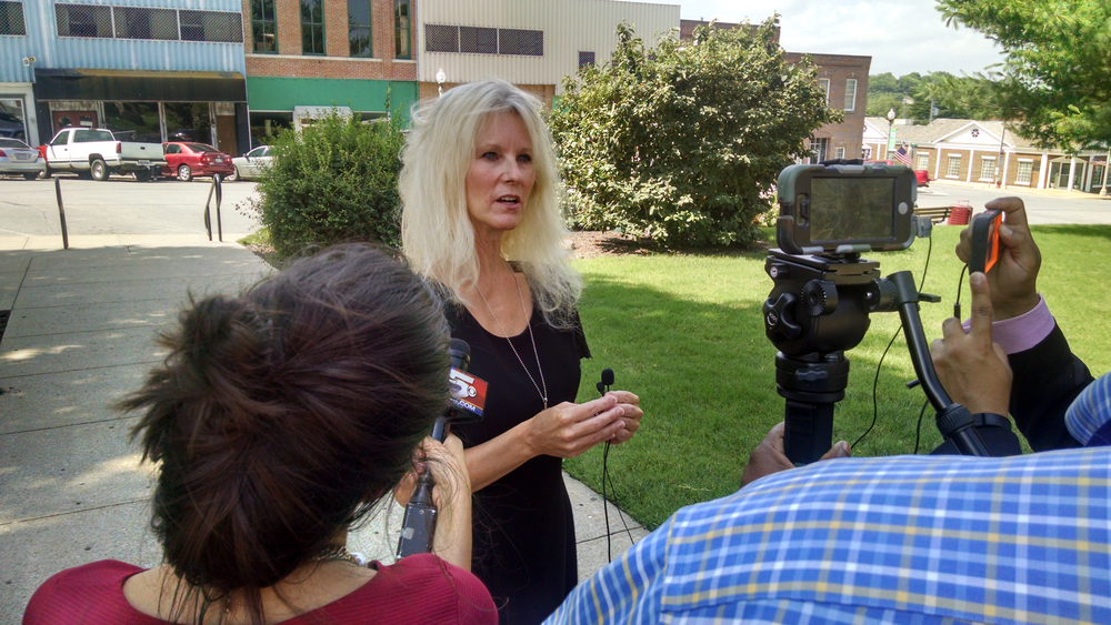 JEANETTE BROWNING FAUBION/Citizen photo Shelly Denham speaks to media members Tuesday, June 14 outside the Platte County Courthouse in Platte City. Denham is the mother of Grayden Denham, considered a person of interest in a quadruple homicide investigation. Grayden Denham appeared in court earlier in the day for a preliminary hearing in a felony stolen car charge filed against him related to the homicide investigation.