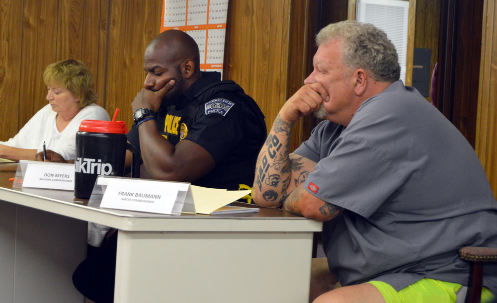 BRENT ROSENAUER/Citizen photo Ferrelview police chief Daniel Clayton, center, participated in discussion with the village's board of trustees after the monthly meeting came back into open session Tuesday, June 14 at city hall in Ferrelview, Mo.
