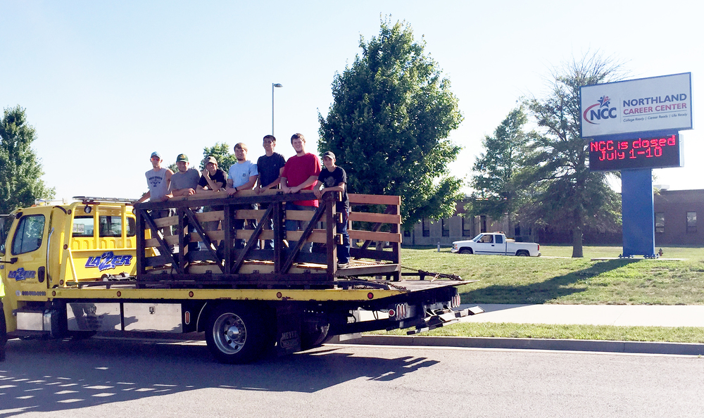 Contributed photo Platte County High School and Northland Career Center students recently completed construction of a walking bridge for the City of Platte Woods. The bridge was shipped to the city Thursday, June 16, and students posed for one last picture with it before it left on a tow truck.