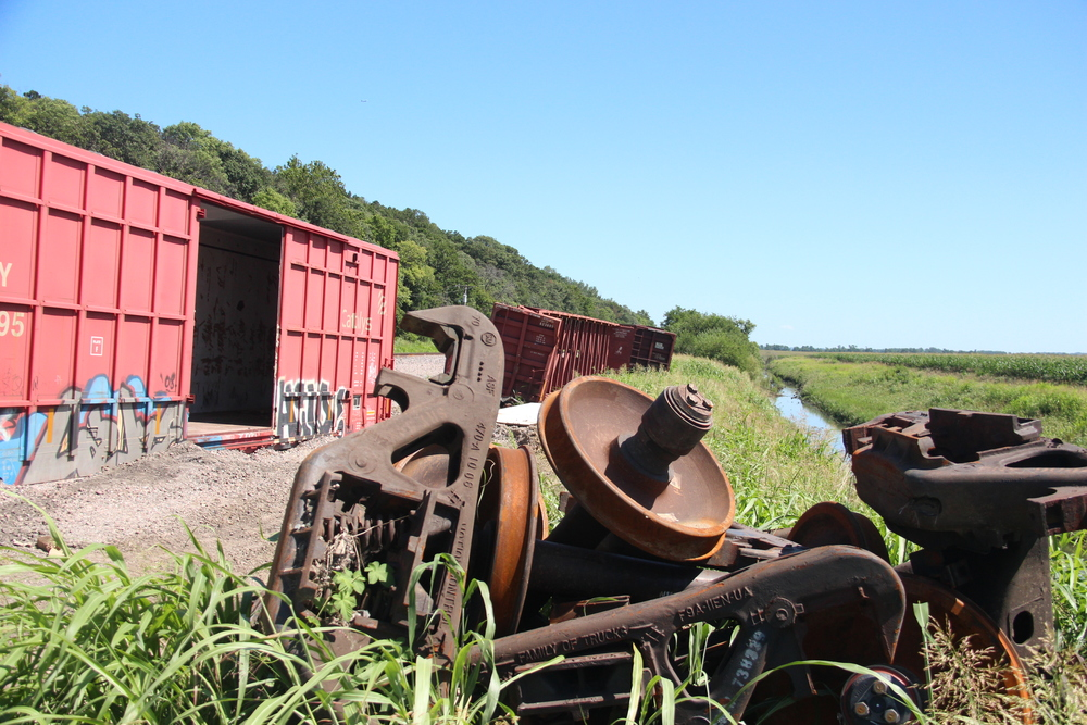 ROSS MARTIN/Citizen photo Months after a train derailment near Farley, Mo., boxcars and wheel axles remain on Burlington Northern Santa Fe property along the rail line. An official with BNSF said cleanup should happen soon.