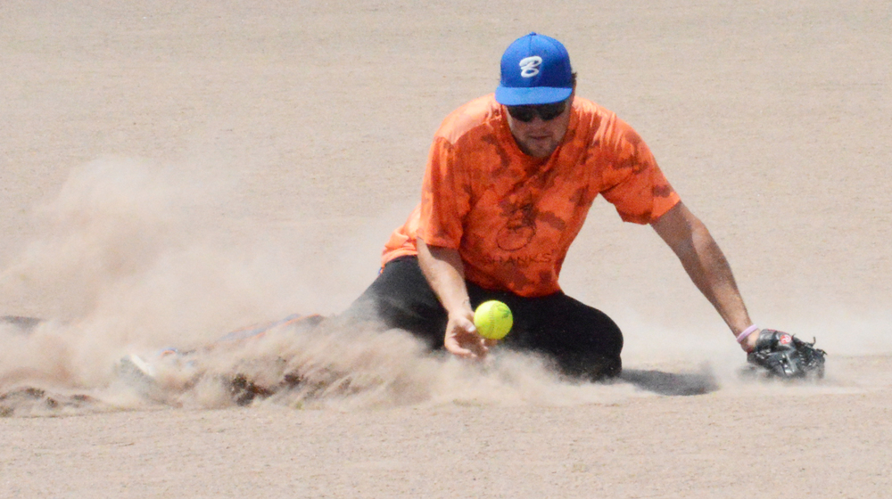 BRENT ROSENAUER/Citizen photo Robbie Campbell of Team Shanks makes a sliding stop on a groundball during a game Saturday, July 30 at Platte Ridge Park in the second annual Clifford Shanks memorial softball tournament.