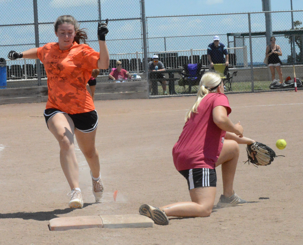 BRENT ROSENAUER/Citizen photo Cacy Williams, right, takes a throw as Moriah Rogers tries to reach first base during a game Saturday, July 30 at Platte Ridge Park in the second annual Clifford Shanks memorial softball tournament.