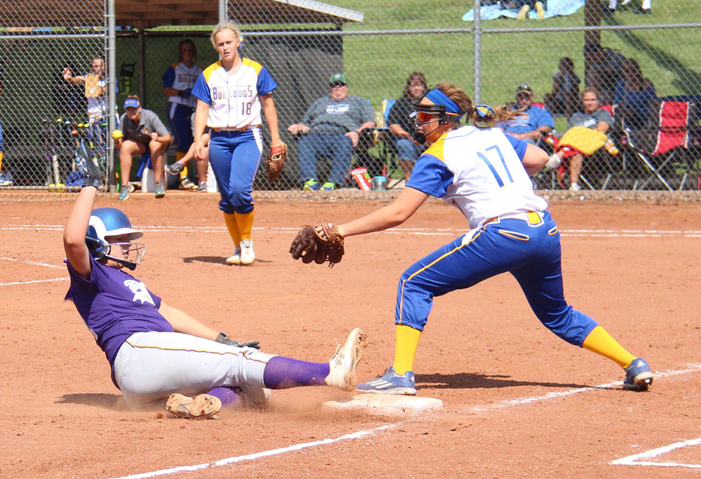 ROSS MARTIN/Citizen photo North Platte freshman pitcher Jordyn Smith slides safely into third base during a North Platte Invitational game against East Buchanan on Saturday, Aug. 20 at Dean Park in Dearborn, Mo.