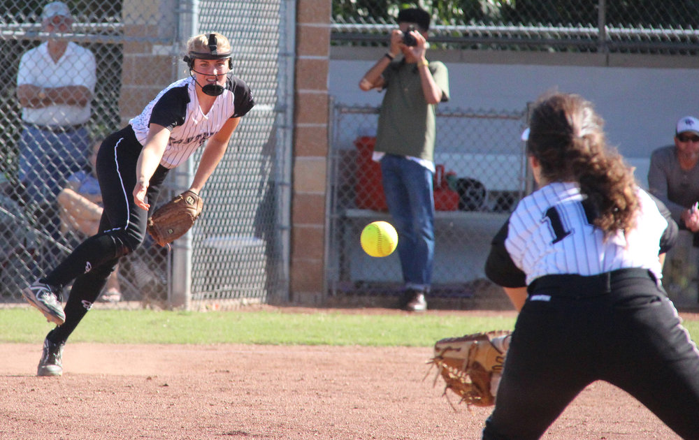 ROSS MARTIN/Citizen photo Park Hill South third baseman Georgia Clark, left, throws across the field to first baseman Jessie Hagen to record an out against Staley in a game played Monday, Aug. 22 at Park Hill South High School in Riverside, Mo.