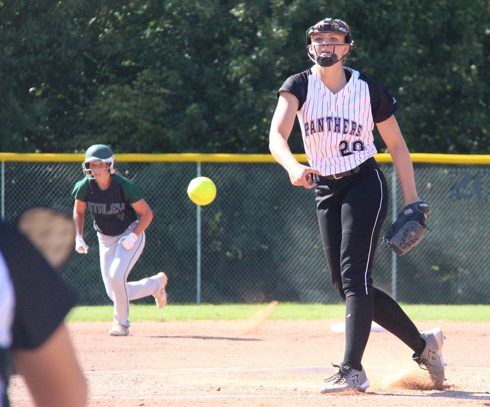 ROSS MARTIN/Citizen photo Park Hill South senior pitcher Olivia Kinsey delivers a pitch against Staley on Monday, Aug. 22 at Park Hill South High School in Riverside, Mo.