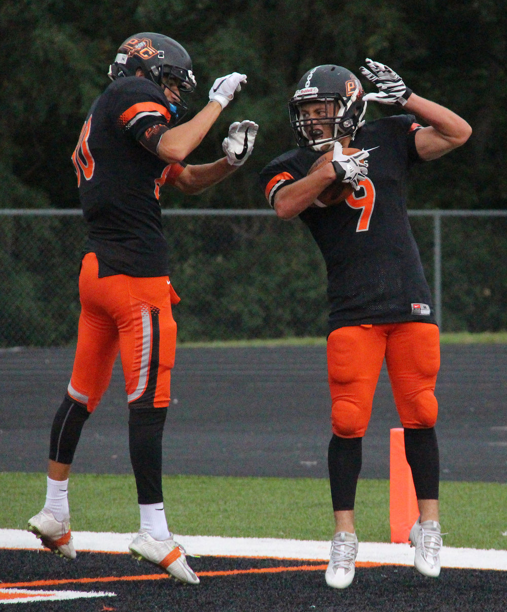 ROSS MARTIN/Citizen photo Platte County senior wide receiver TJ Guillory (9) celebrates his first quarter touchdown with sophomore wide receiver Dylan Gilbert on Friday, Aug. 19 against Grandview at Pirate Stadium.