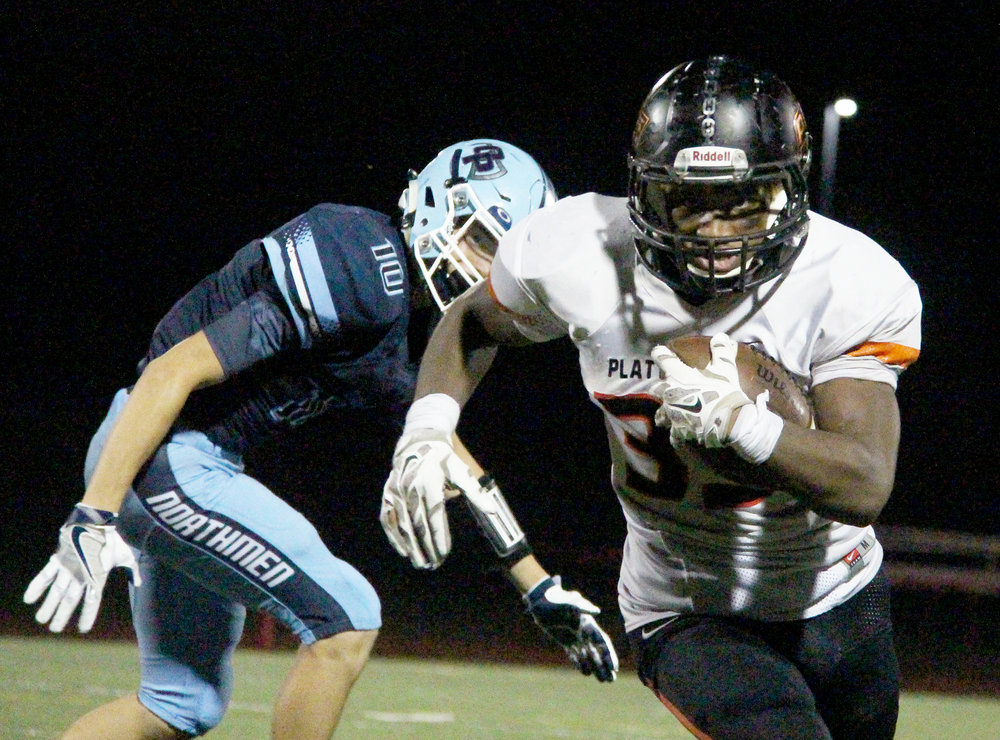 ROSS MARTIN/Citizen photo Platte County senior running back Mike McNair runs up field past Oak Park Clayton Brown on Thursday, Aug. 25 at North Kansas City District Activities Complex in Kansas City, Mo. McNair ran for 148 yards and two touchdowns in the Pirates' 37-6 win.