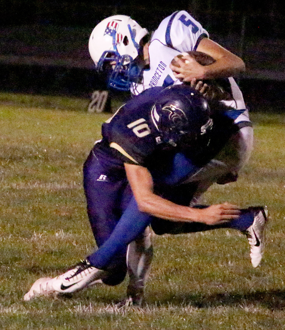 ROSS MARTIN/Citizen photo North Platte senior linebacker Ben French, left, tackles Princeton tight end Camden Hartley in the first quarter Friday, Aug. 26 at North Platte High School in Dearborn, Mo.
