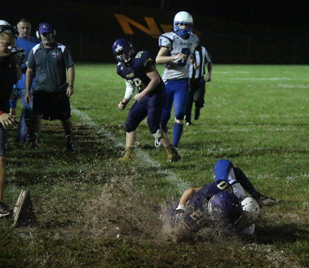ROSS MARTIN/Citizen photo  North Platte junior cornerback Corbin Green kicks up water on the sideline after being tackled following an interception.
