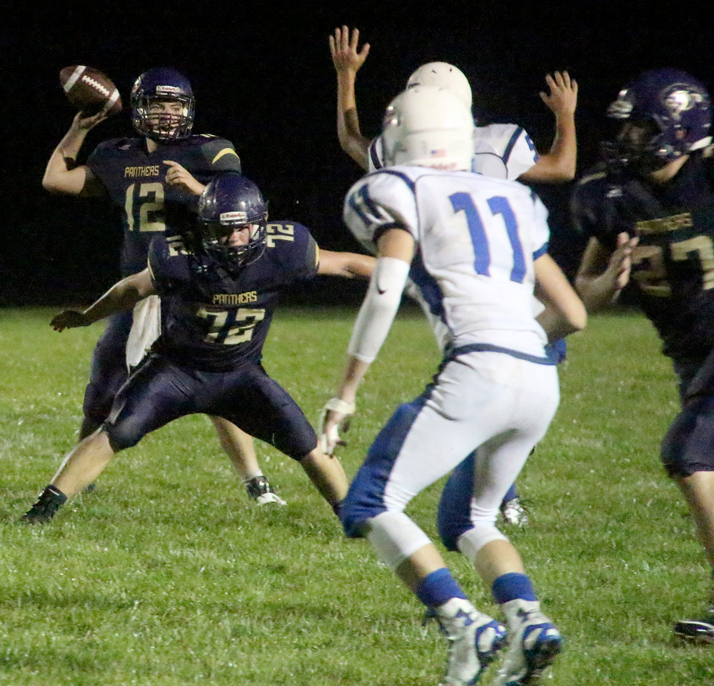 ROSS MARTIN/Citizen photo North Platte junior Van French (72) blocks as junior quarterback Austin Snook prepares to throw during the second half.