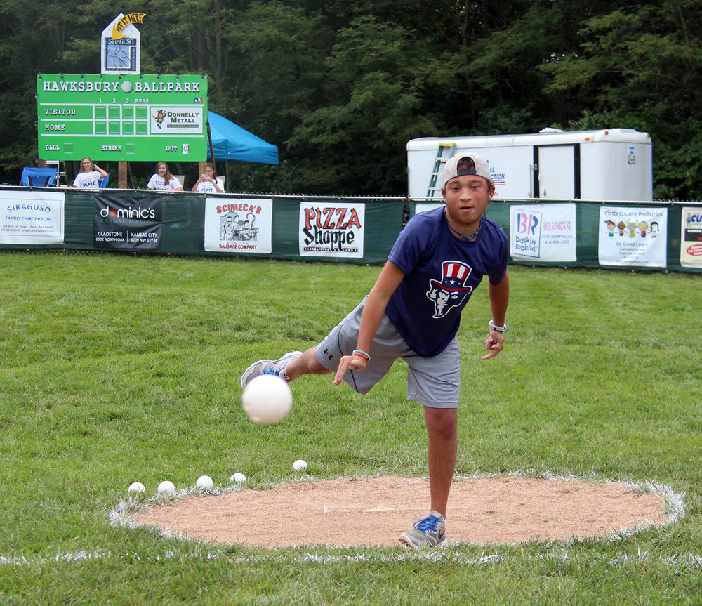 ROSS MARTIN/Citizen photo Phillip Scimeca throws out the ceremonial first pitch for the sixth annual Phillip Scimeca Wiffle Ball Classic, held Sunday, Sept. 4 in his neighborhood in Kansas City, Mo.