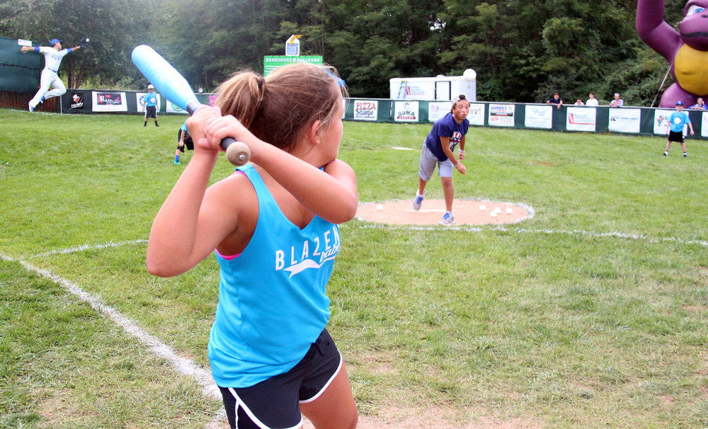 ROSS MARTIN/Citizen photos Phillip Scimeca pitches to sister Ella Scimeca during the sixth annual Phillip Scimeca Wiffle Ball Classic, held Sunday, Sept. 4 in their neighborhood in Kansas City, Mo.