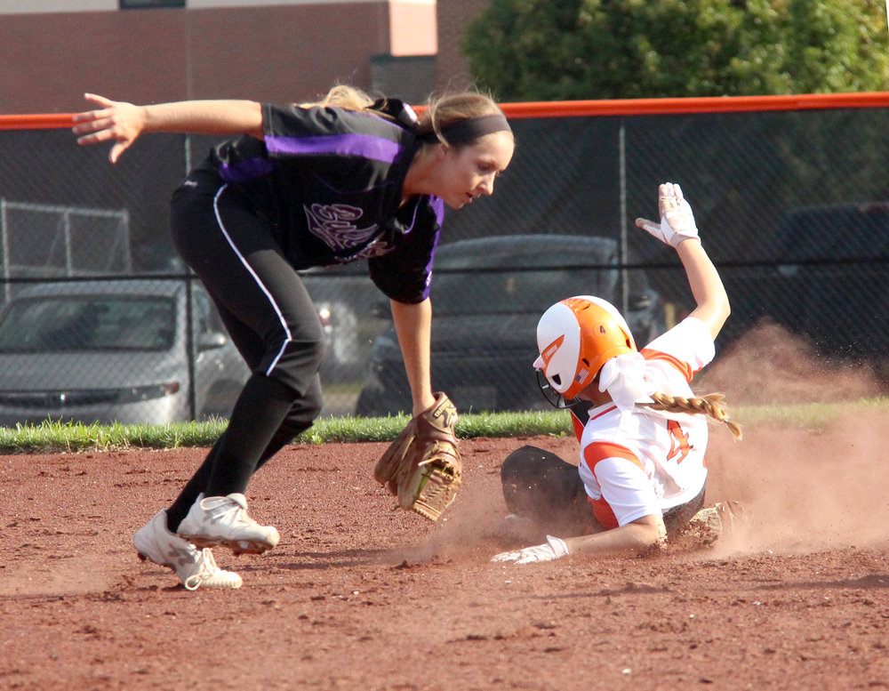 ROSS MARTIN/Citizen photo Platte County sophomore left fielder Janessa Barmann (4) slides in safely to second base during a game against Kearney on Thursday, Sept. 1 at Platte County High School.