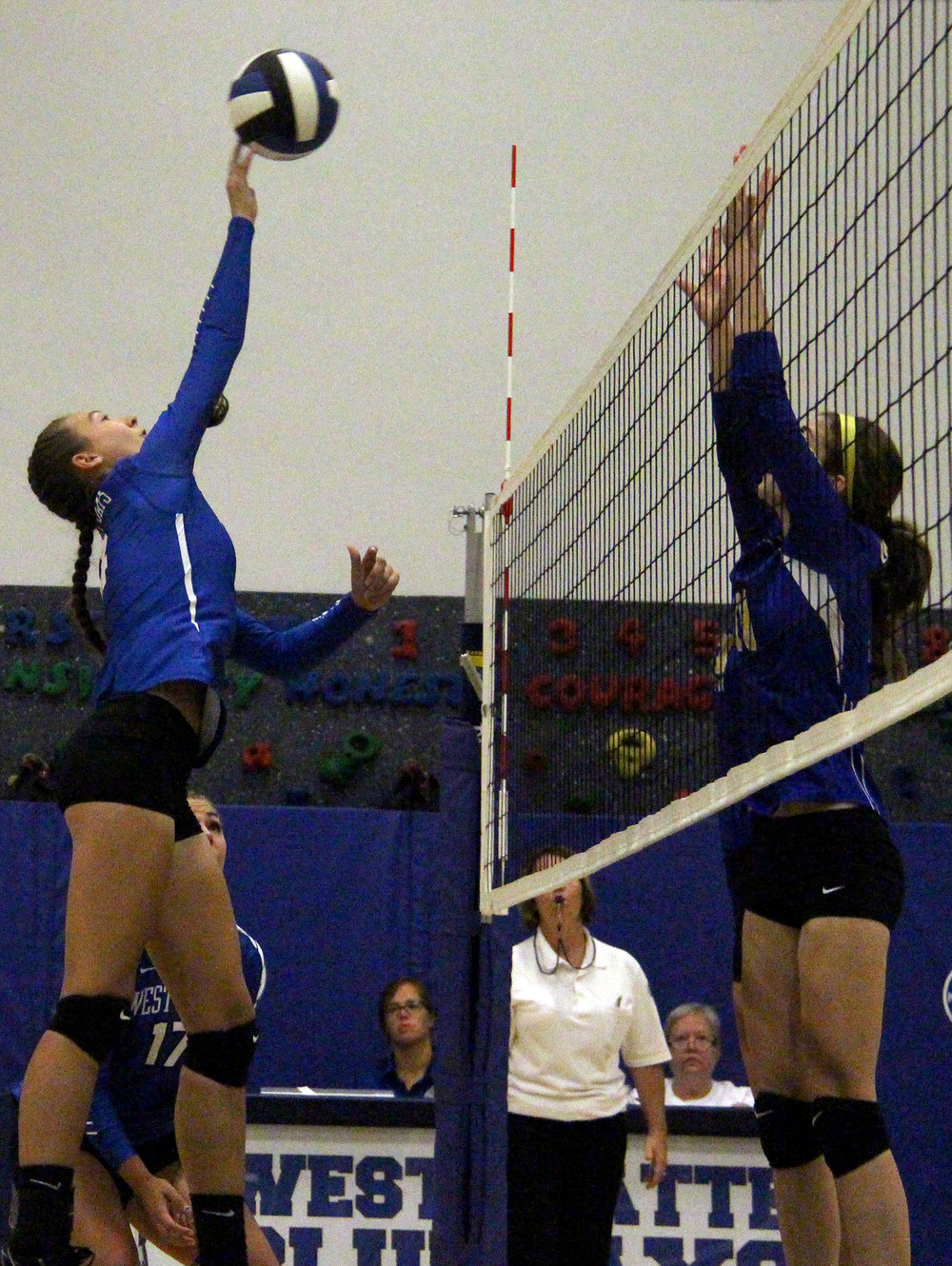 ROSS MARTIN/Citizen photo West Platte junior Ciara Davies tips a ball over the net against the Bulldogs defense.