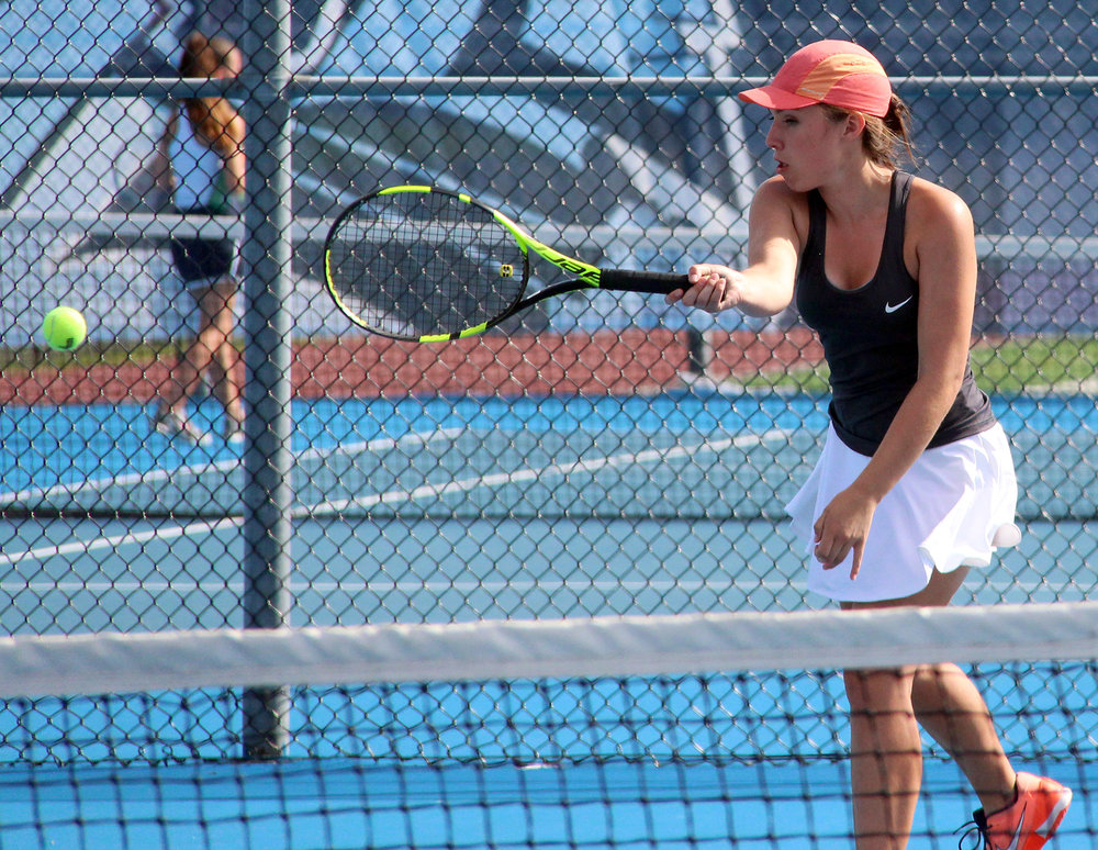 ROSS MARTIN/Citizen photo Platte County senior Madalyn Ivy hits a forehand shot during a doubles match against Oak Park on Thursday, Sept. 1 at Oak Park High School in Kansas City, Mo. Platte County swept the Lady Oakies 9-0.