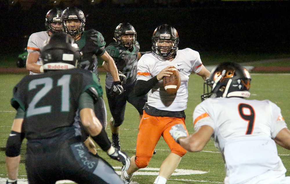 ROSS MARTIN/Citizen photo Platte County senior quarterback Justin Mitchell (center) looks to pass while scrambling against Staley on Friday, Sept. 2 at North Kansas City District Activities Complex in Kansas City, Mo. Staley won 55-42.