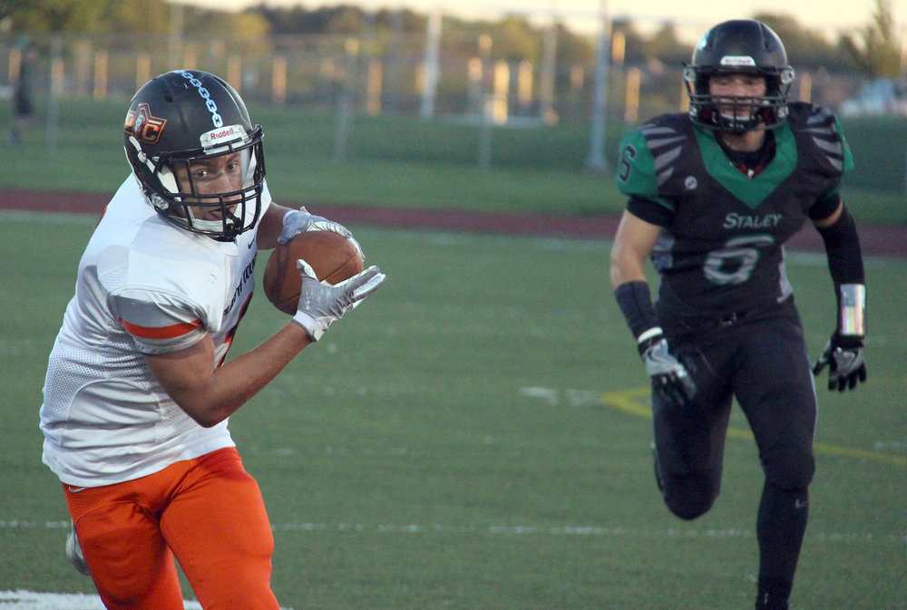 ROSS MARTIN/Citizen photo Platte County senior wide receiver TJ Guillory turns up field after making a catch in the first half against Staley on Friday, Sept. 2 at North Kansas City District Activities Complex in Kansas City, Mo.