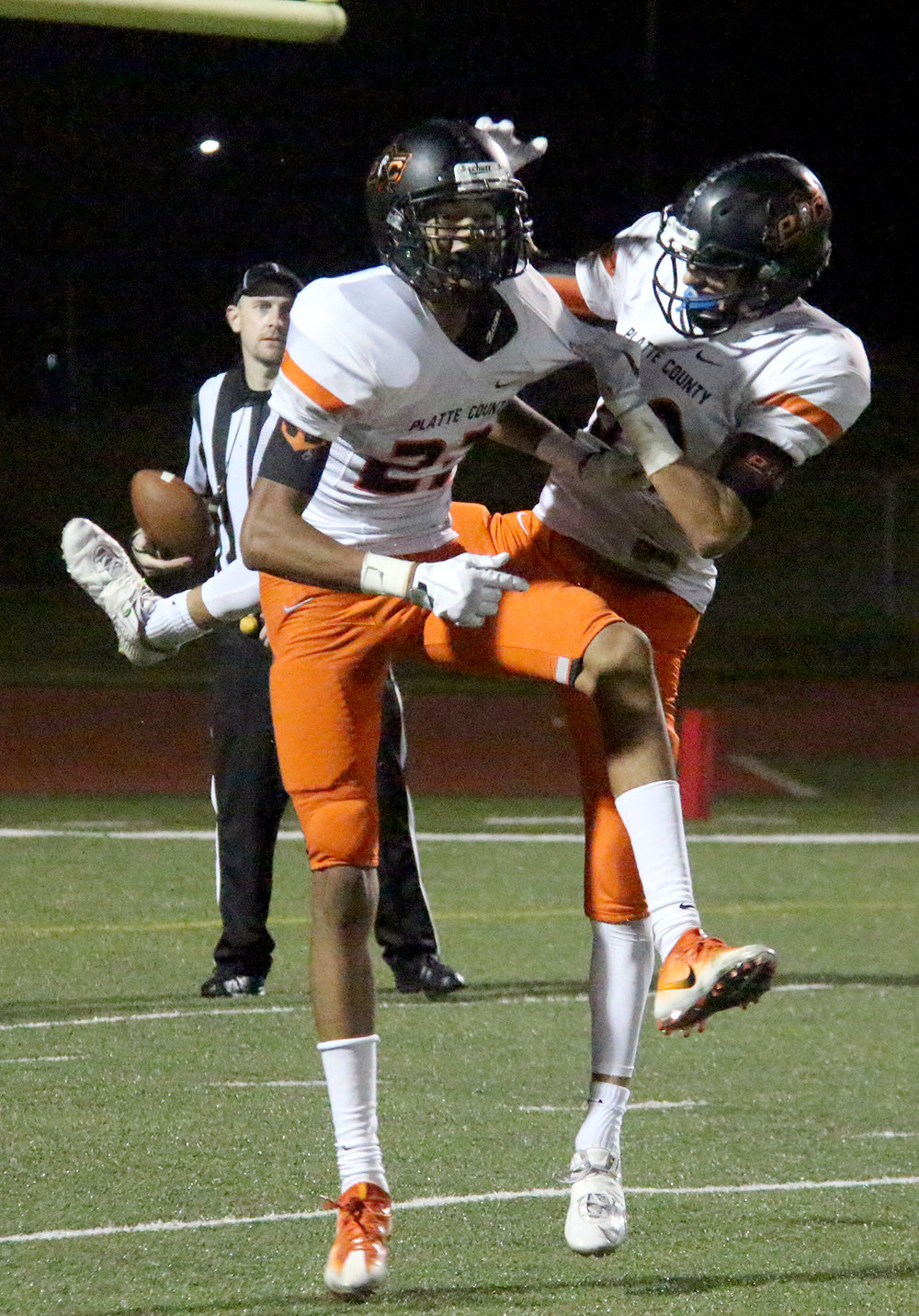 ROSS MARTIN/Citizen photo Platte County senior wide receiver John Watts (front) celebrates his 40-yard touchdown catch in the second half with sophomore wide receiver Dylan Gilbert.