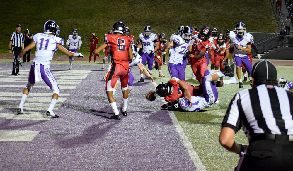 ANTHONY CRANE/Special to The Citizen Park Hill senior running back Seven Wilson pushes over the goal line for a touchdown run in the third quarter of a 24-23 victory against Park Hill South on Friday, Sept. 2 at Park Hill District Stadium in Kansas City, Mo.